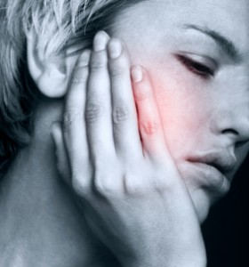Young woman in pain is having toothache pain