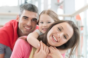 Dental Implant Specialist: Family with Healthy Teeth