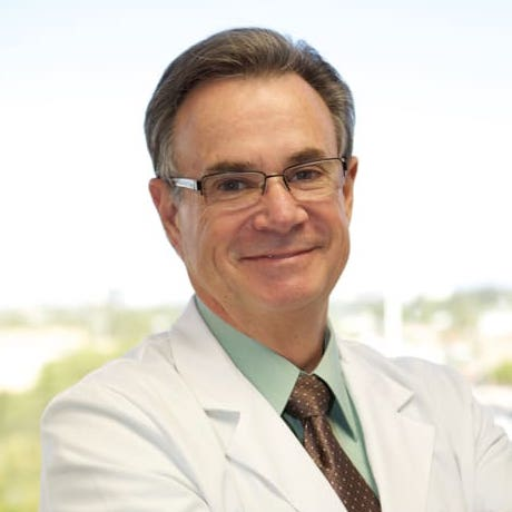 Dr. Stone, a specialist in tooth extractions and dental implants